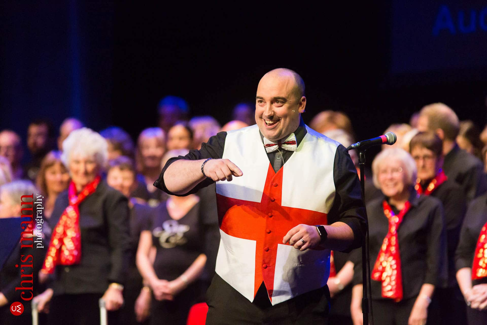 Choirmaster Sean Peters at Choiroke 2016 concert Dorking Halls