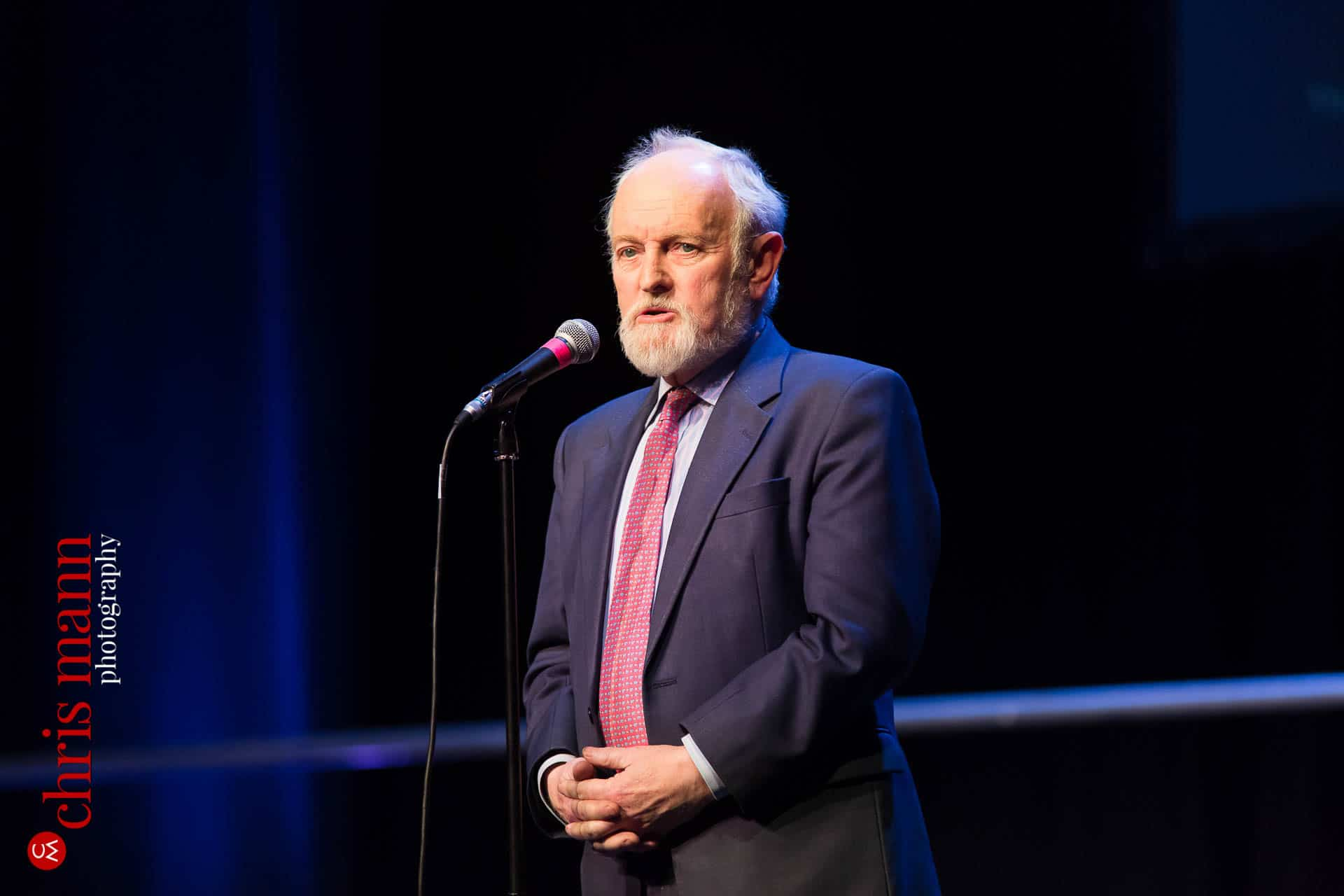 Sir Richard Stilgoe speaks at Choiroke 2016 concert Dorking Halls