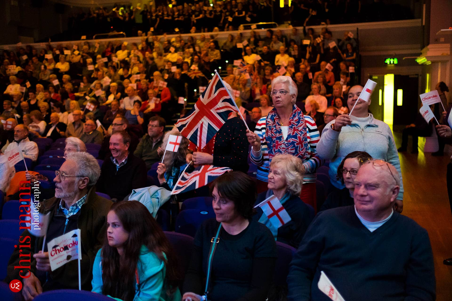 Patriotic audience wave flags St George's Day Choiroke 2016 concert Dorking Halls