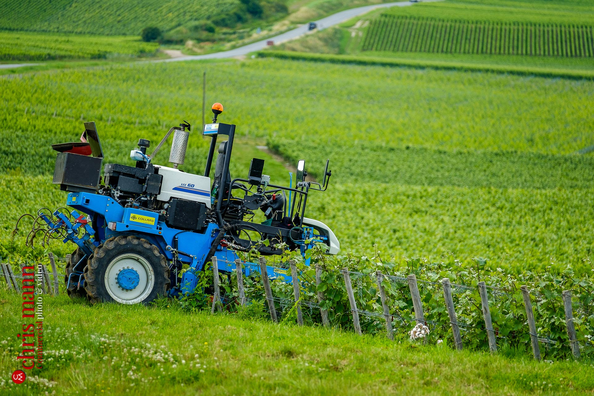 tractor in Champagne vineyards near Reims Picardy France