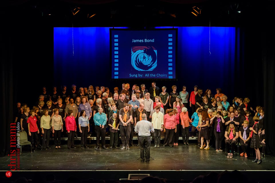 massed choirs rehearse James Bond theme Choiroke 2017 concert | Harlequin Redhill