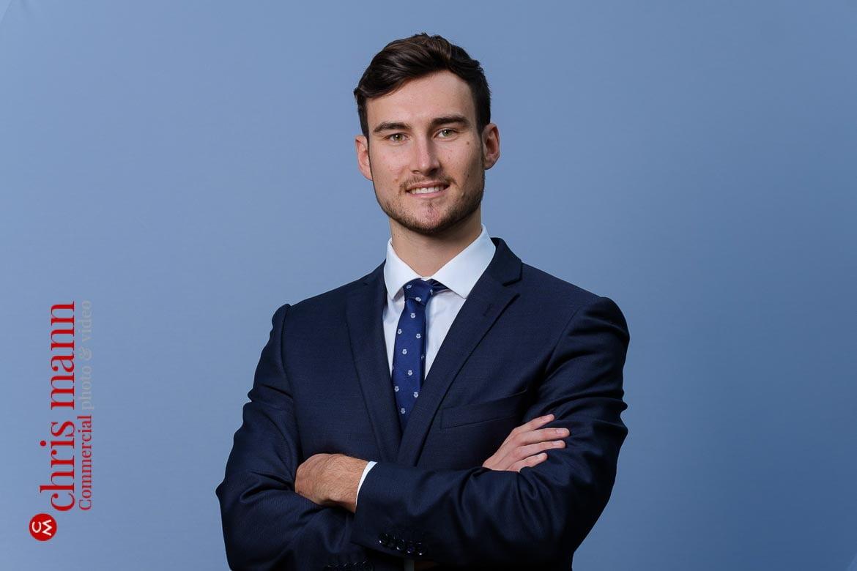 Socially distanced headshots - business portrait on plain background